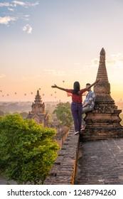 couple sunrise Bagan, men woman sunset Bagan .old city of Bagan Myanmar, Pagan Burma Asia old ruins Pagodas and Temples