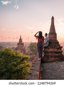 couple sunrise Bagan, men woman sunset Bagan .old city of Bagan Myanmar, Pagan Burma Asia old ruins Pagodas and Temples