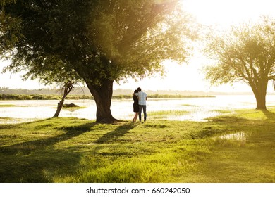 Couple at sunset by the water