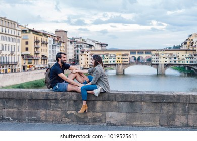 Couple at sunset in front of Ponte Vecchio, Florence