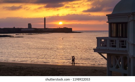 Couple at Sunset in La Caleta Cadiz Spain