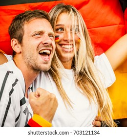 Couple Supporting Germany at the Stadium