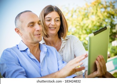 couple surfing on the web at resort -Stock