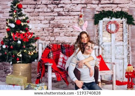 Couple Sweaters Hug Decorated Christmas Room Stock Photo Edit Now