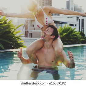 Couple in a swimming pool together in summer