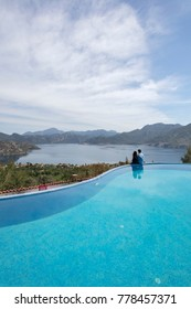 A Couple and Swimming Pool with a view on Aegean Sea at the  Boutique Hotel