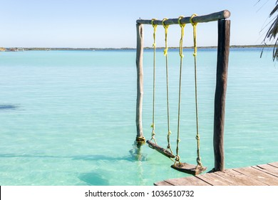 A couple of swings in the lake of Bacalar, in Mexico