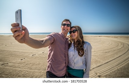 Couple Takes Picture of Themselves on Beach