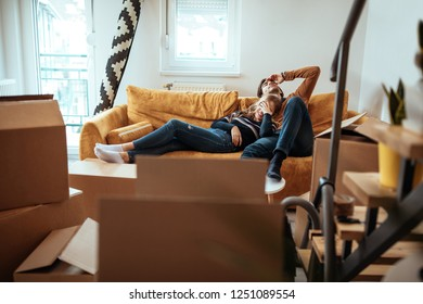 Couple taking a break from unpacking in their new home