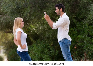 couple taking photo outdoor with digital tablet, selective focus