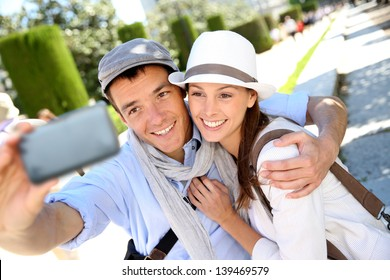 Couple taking picture of themselves with smartphone