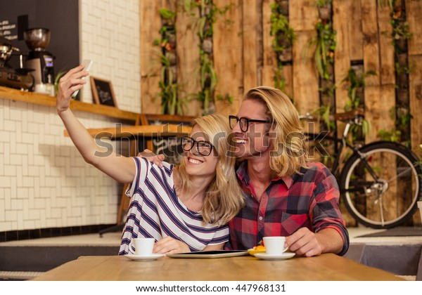 Couple taking a selfie in the cafe