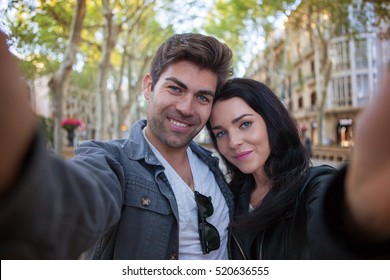 couple taking selfie on vacations