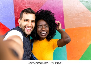 Couple taking selfie in the park