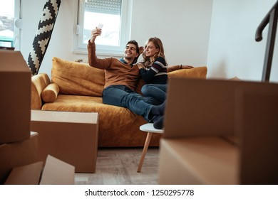 Couple taking selfie in their new apartment