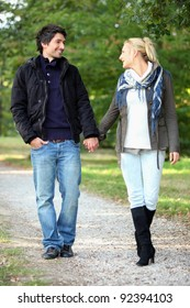 Couple taking a walk in the park