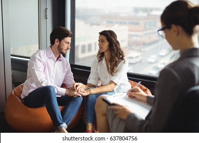 Couple talking to a marriage counselor during therapy