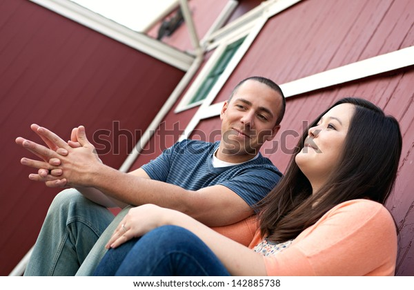 Couple Talking Together - Young happy couple enjoying each others company outdoors.