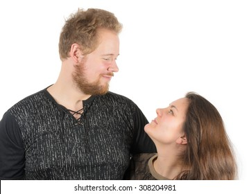 couple: tall man and short woman smiling and looking at each other