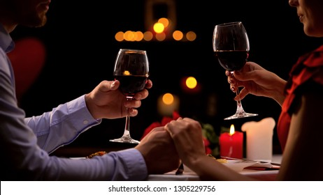 Couple tasting red wine in high-quality restaurant, winemaking traditions, date