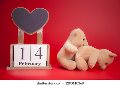 Couple Teddy Bears on red background. Valentines Day card. Love heart.