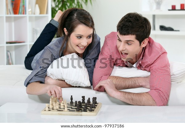 A couple of teenagers playing chess.