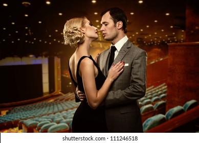 Couple in theatre interior