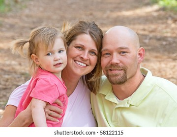 Couple With Their Daughter