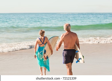 Couple with their surfboard on the beach