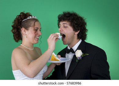 A couple with their wedding cake
