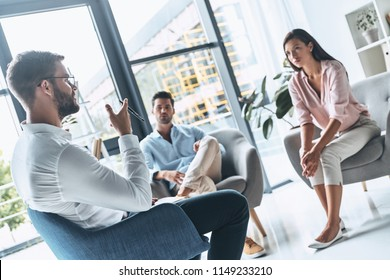 Couple therapy. Young married couple listening to psychologist while sitting on the therapy session