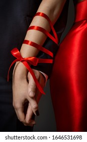 Couple Tied Hands, Woman and Man Arms Bonded Together by Red Ribbon, Relationship Concept