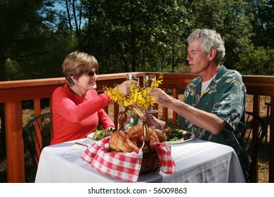 """a couple toast a glass of wine at an outdoor cafe or """"bed and breakfast"""""""