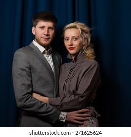 couple together hugs blue background blinds