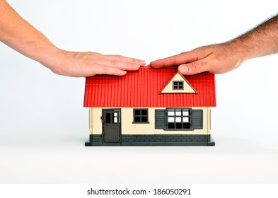 Couple touch a toy house isolated on white background - copy space.Concept photo of real estate business, home  Insurance, house rental,buying, renting, mortgage, finance,service and repair costs