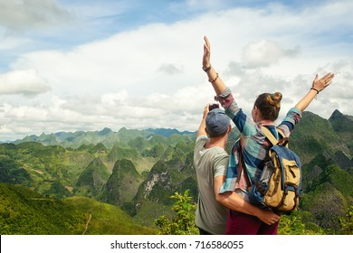 Couple of tourists making selfie on the background of beautiful karst mountains, North Vietnam.Mountains and landscape, travel to Asia, happiness emotion, summer holiday concept.