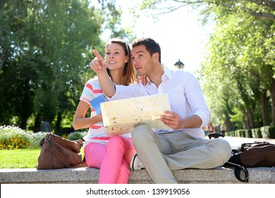 Couple of tourists relaxing in park