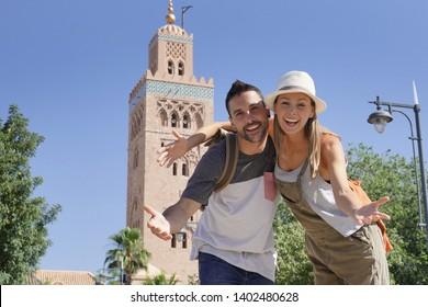 Couple of tourists walking in Koutoubia gardens, Marrakech