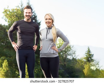 Couple training stretching after workout in nature. Young woman and man during workout in nature