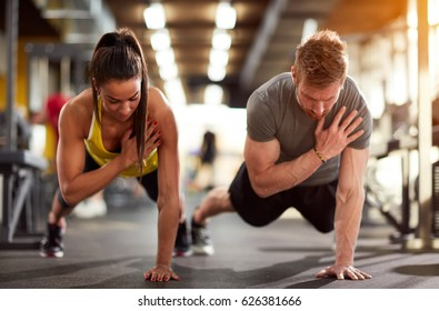 Couple training together in fitness center