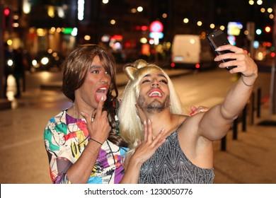 Couple of transvestites taking a selfie
