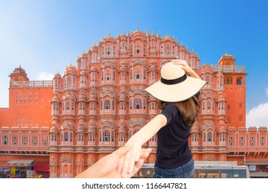 Couple travelers man and woman follow holding hands at Hawa Mahal palace in Jaipur, Rajasthan, India, Love and Travel happy emotions lifestyle concept, Couple summer vacation travel