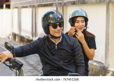 Couple are traveling by motorcycle.