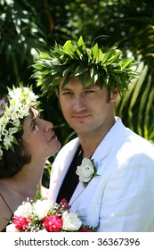 couple at Tropical wedding with flowers crowns