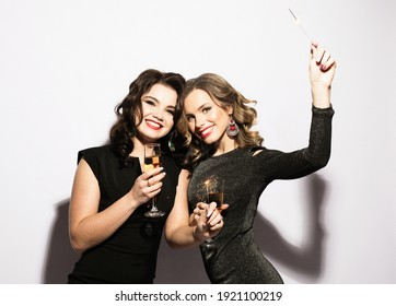 Couple of Two Rich Women Laughing with Crystal of Champagne and Sparkle . Luxury. Party