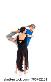 A couple of two young, attractive, modern ballet dancers, one woman and one man,  in dynamic action figure, warming up, on white background, studio image.