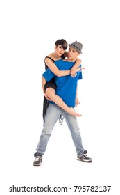 A couple of two young, attractive, modern ballet dancers, one woman and one man,  in dynamic action figure, with hands and legs raised up in the air, on white background, studio image.