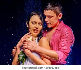 Couple  under  water drop on dark background . Valentine day.