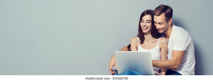 Couple using laptop, close to each other. Caucasian models - internet, technology, family, love, relationship, happiness concept. Horizontal banner composition . Copyspace for slogan or text message.