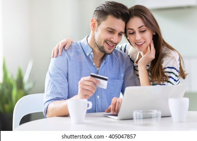 Couple using laptop together